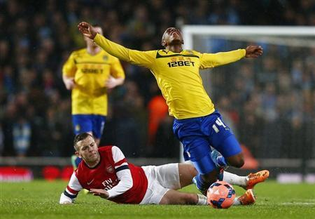 Arsenal's Jack Wilshere fouls Coventry City's Franck Moussa during their English FA Cup fourth round soccer match at The Emirates in London