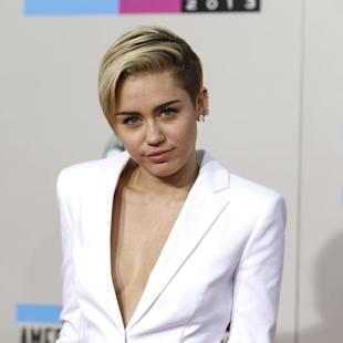 Miley Cyrus, Arias murder trial top Yahoo's 2013 searches