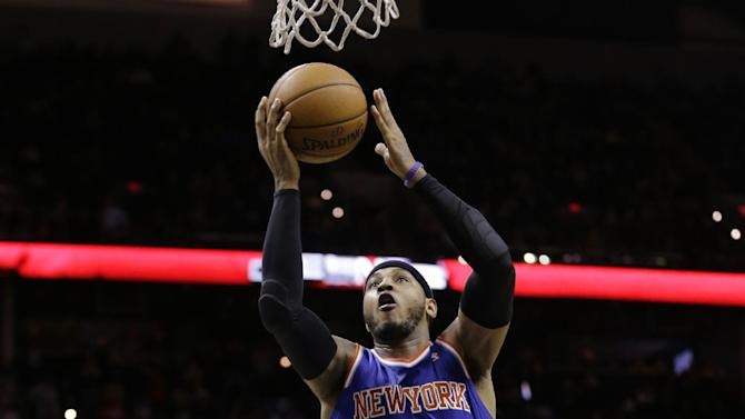 New York Knicks' Carmelo Anthony (7) scores over San Antonio Spurs' Tim Duncan (21) during the second half on an NBA basketball game, Thursday, Jan. 2, 2014, in San Antonio.  New York won 105-101