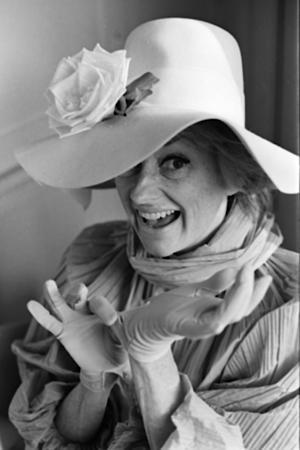 FILE-- In this in this March 18, 1966 file photo, comedian Phyllis Diller models one of her 300 hats in Hollywood, Calif. Diller, the housewife turned humorist who aimed some of her sharpest barbs at herself, died Monday, Aug. 20, 2012, at age 95 in Los Angeles. (AP Photo/File)