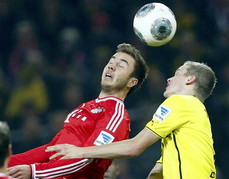 Bayern Munich's Goetze goes for a header with Borussia Dortmund's Bender during their German first division Bundesliga soccer match in Dortmund
