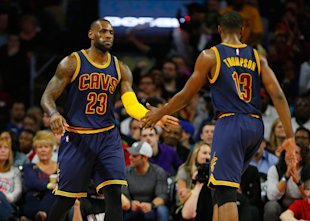 Tristan Thompson congratulates LeBron James on making the trades. (Gregory Shamus/Getty Images)