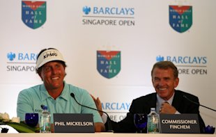 Phil Mickelson (left) and PGA Tour commissioner Tim Finchem (Getty Images)