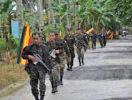 """Moro Islamic Liberation Front (MILF) rebels on patrol on the southern Philippine island of Mindanao in 2011. The Philippines said it has brokered a """"significant"""" agreement with the Muslim rebels on how to end a decades-long insurgency, but warned that major issues still needed to be resolved"""