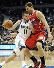 Minnesota Timberwolves' Jose Juan Barea (11) drives against Los Angeles Clippers' Blake Griffin (32) during the first half of an NBA basketball game, Thursday, Jan. 17, 2013, in Minneapolis. (AP Photo/Jim Mone)