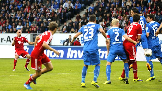 Bayern's Mario Mandzukic of Croatia, 2nd right, scores his side's equalizing goal after a free kick by Bayern's Franck Ribery of France, left, during a German first division Bundesliga soccer match between TSG 1899 Hoffenheim and Bayern Munich in Sinsheim, Germany, Saturday, Nov.2, 2013