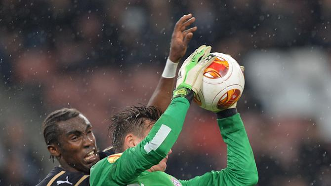 Dinamo's Lee Addy, left. fights for the ball with Przemyslaw Tytonfrom PSV Eindhoven during a Europa League group B  soccer match between PSV and Dinamo Zagreb at the Philips stadium in Eindhoven, southern Netherlands, Thursday, Nov.7, 2013