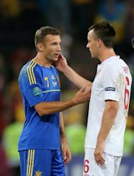 Andriy Shevchenko congratulates England's John Terry after the Euro 2012 match in Donetsk on June 19. Shevchenko is to join a pro-business party called Ukraine Forward! whose leader, Nataliya Korolevska, has broken away from the opposition party of jailed ex-prime minister Yulia Tymoshenko