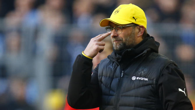 Borussia Dortmund coach Klopp gestures during Bundesliga soccer match against Schalke 04 in Dortmund