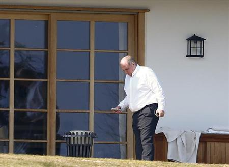 Uli Hoeness, resigned president and chairman of Bayern Munich, walks outside his house in the Bavarian town of Bad Wiessee, March 14, 2014. REUTERS/Michael Dalder