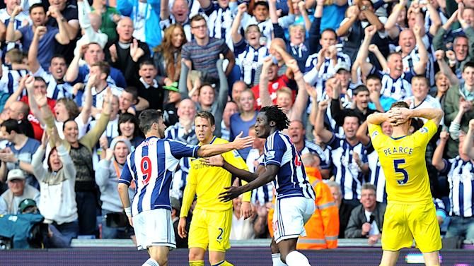 West Brom's Romelu Lukaku, right, celebrates scoring the winner against Rading with team-mate Shane Long