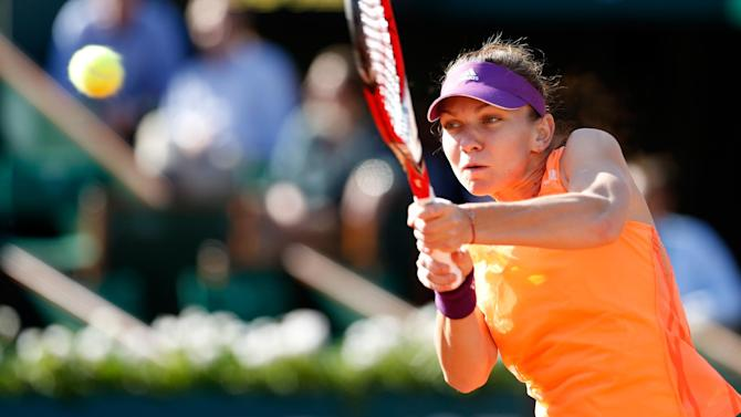 French Open women - Halep conjures more tricks to reach first slam final