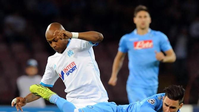 Napoli's Jose Callejon is airborne as Marseille's Andre Ayew, left, challenges him, during a Champions League, group F, soccer match between Napoli and Marseille, at the Naples San Paolo stadium, Italy, Wednesday, Nov. 6, 2013