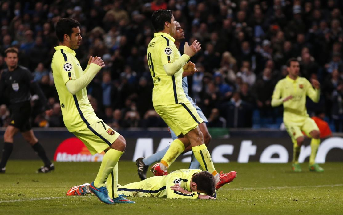 Football: Barcelona's Lionel Messi looks dejected after having his penalty saved