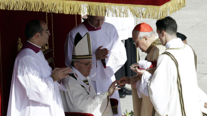 Pope Francis is bestowed the Fisherman's Ring by Cardinal Angelo Sodano during his inaugural Mass, in St. Peter's Square at the Vatican, Tuesday, March 19, 2013. (AP Photo/Andrew Medichini)