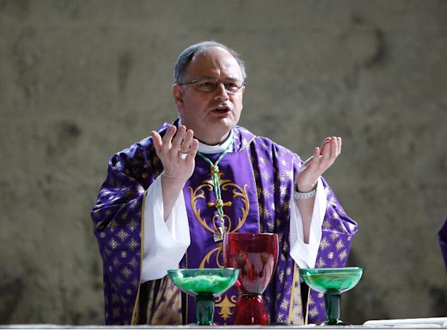 Jean-Philippe Nault, Bishop of Digne celebrates a mass in homage to  the victims of he Germanwings jetliner crash, inside the cathedral Notre Dame de Bourg, in Digne, French Alps, Saturday, March 28,