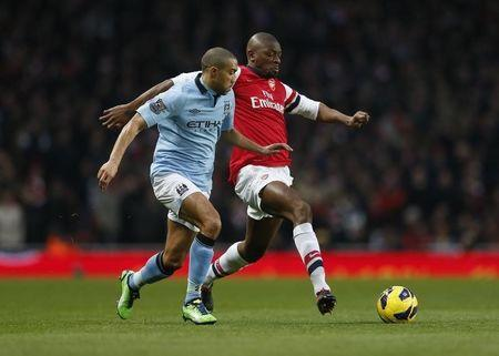 Arsenal's Diaby challenges Manchester City's Clichy during their English Premier League soccer match at the Emirates Stadium in London
