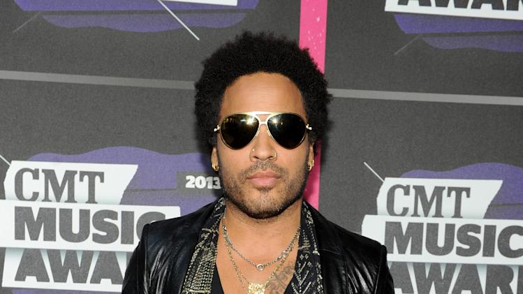 Lenny Kravitz arrives at the 2013 CMT Music Awards at Bridgestone Arena on Wednesday, June 5, 2013, in Nashville, Tenn. (Photo by Frank Micelotta/Invision/AP)