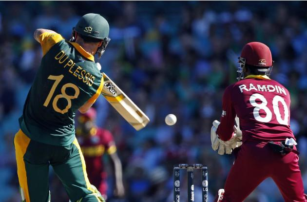 South Africa's Faf du Plessis hits a catch to West Indies wicketkeeper Denesh Ramdin and is caught out for 62 runs during their Cricket World Cup match at the SCG
