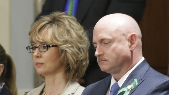 Former Arizona Rep. Gabrielle Giffords and her husband Mark Kelly watch President Barack Obama's State of the Union address during a joint session of Congress on Capitol Hill in Washington, Tuesday Feb. 12, 2013. (AP Photo/Pablo Martinez Monsivais)
