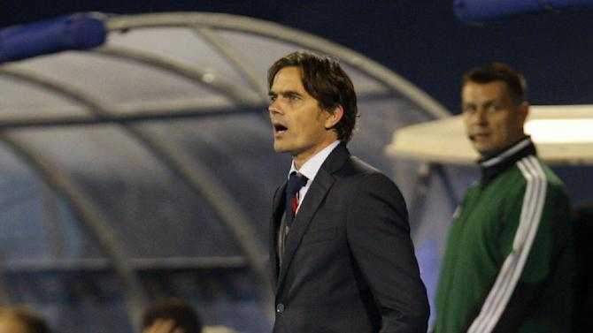 PSV's head coach Phillip Cocu reacts during a Europa League group B soccer match between PSV Eindhoven and Dinamo Zagreb, in Zagreb, Croatia, Thursday, Oct. 24, 2013