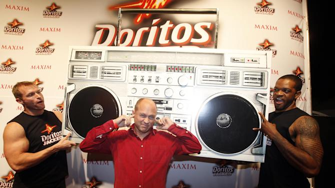 COMMERCIAL IMAGE - In this photograph taken by AP Images for Doritos, Mike Judge arrives at the Doritos JACKED Maxim Party in Austin, Texas, Thursday, March 15, 2012. The 56-foot-tall vending machine JACKED Stage was unveiled at SXSW to debut amped up new Doritos JACKED chips. (Erich Schlegel/AP Images for Doritos)