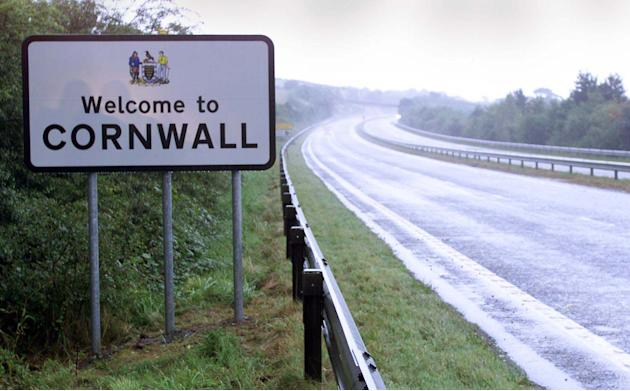 FILE - This Aug. 8, 1999 file photo shows a road sign on the road going into Cornwall, in Launceston, England, Thursday April 24, 2014. The British government said Thursday April 24, 2014 that Cornish