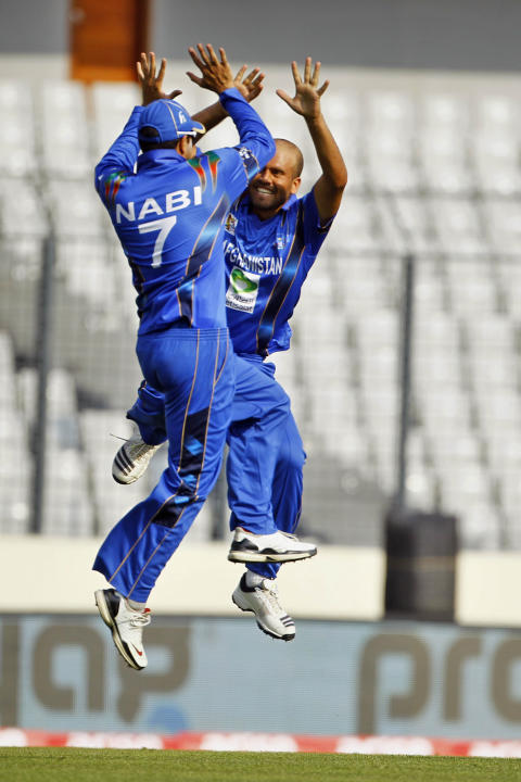 Afghanistan's Mirwais Ashraf, right, celebrate with teammate Mohammad Nabi, after taking the wicket of Sri Lanka's Mahela Jayawardene during the Asia Cup one-day international cricket tournament betwe