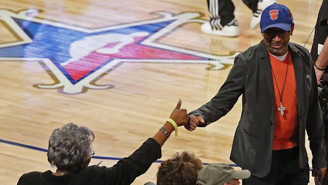Vice Chairwoman of the Democratic National Committee Donna Brazile, left fist bumps Director Spike Lee before the skills competition at the NBA All Star basketball game, Saturday, Feb. 15, 2014, in New Orleans