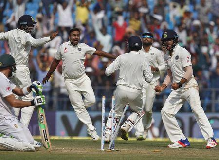India's Mishra celebrates along with his captain Kohli after taking the wicket of South Africa's Plessis during the third day of their third test cricket match in Nagpur
