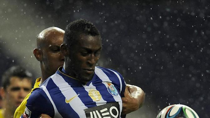 FC Porto's Jackson Martinez, right, from Colombia vies for the ball Pacos Ferreira's Flavio Boaventura, from Brazil, in a Portuguese League soccer match at the Dragao stadium in Porto, Portugal, Sunday, Feb. 9, 2014. Jackson scored once in Porto's 3-0 victory