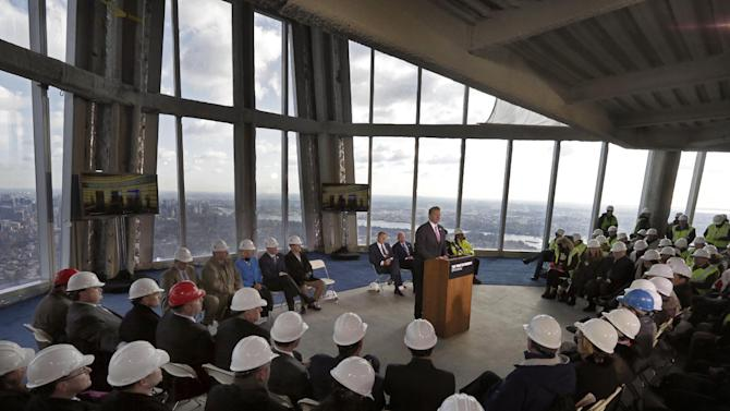 Legends Chairman & CEO David Checketts, at podium center, of the company that will run the observation deck on the 100th floor of the One World Trade Center building, address a news conference in the venue, in New York, Tuesday, April 2, 2013. The observation deck, that will not open until 2015, will occupy the tower's 100th through 102nd floors. Elevators will whisk visitors to the top in just one minute but the experience of visiting the attraction will take an hour. (AP Photo/Richard Drew)
