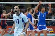Italy's Andrea Giovi (in front) celebrates winning the second set during the Men's quarterfinal volleyball match between the US and Italy in the 2012 London Olympic Games in London on August 8, 2012. AFP PHOTO/KIRILL KUDRYAVTSEV