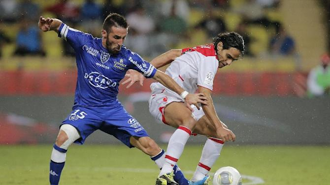 Bastia's Julian Palmieri of France, left, challenges for the ball with Monaco's Falcao of Colombia during their French League One soccer match, in Monaco stadium, Wednesday, Sept, 25, 2013