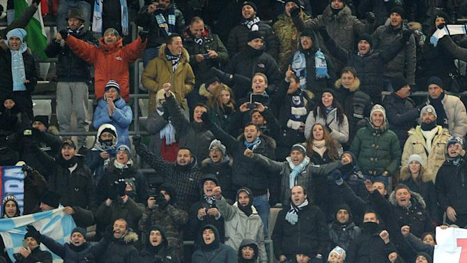 Lazio's  fans react during the Europa League Group J soccer match between Lazio Rome and Legia Warszawa in Warsaw, Poland, Thursday, Nov. 28, 2013