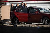 Chicago police stand near where a toddler and a man were fatally shot and a woman was wounded in the 2300 block of south Kenneth Ave in the Lawndale neighborhood Tuesday, Feb. 14, 2017. Police are examining dramatic video that captured the shooting that killed a toddler and a man authorities say was the intended target. (E. Jason Wambsgans/Chicago Tribune via AP)