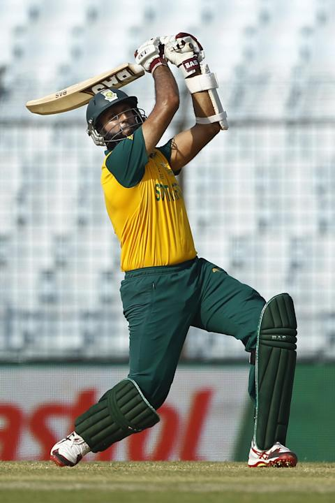 South Africa's Hashim Amla plays a shot during their ICC Twenty20 Cricket World Cup match against New Zealand, in Chittagong, Bangladesh, Monday, March 24, 2014. (AP Photo/A.M. Ahad)