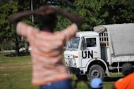 A boy watches as a United Nations truck is loaded with humanitatian aid January 23, 2010 in Leogane, Haiti. The United Nations formally rejected a multi-billion-dollar damages claim for a cholera epidemic in Haiti that has been widely blamed on UN peacekeepers