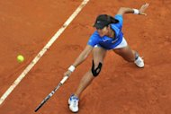 China's Li Na retuns a ball to Russia's Maria Sharapova during the final of the WTA Rome Tennis Masters, on May 20. Li let slip a winning position, leading Sharapova by a set and 4-0 but eventually tasting defeat in a third set tie-breaker