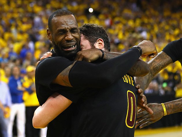 LeBron James and Kevin Love react to the news. (Getty Images)