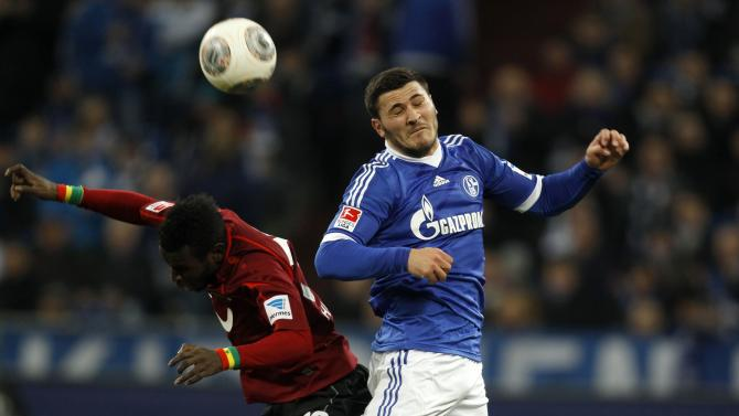 Hanover's Diouf and Schalke 04's Kolasinac jump for a ball during the German first division Bundesliga soccer match in Gelsenkirchen