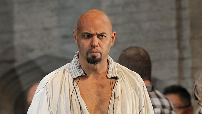 """In this September 2011 photo provided by the Metropolitan Opera, Keith Miller plays Lord Rochefort in Donizetti's """"Anna Bolena,"""" at the Metropolitan Opera in New York. The former University of Colorado fullback has reinvented himself, going from the gridiron to the stage and will appear in Verdi's """"Un Ballo in Maschera,"""" at the Metropolitan Opera. Performances begin Thursday, Nov. 8, 2012. (AP Photo/Metropolitan Opera, Ken Howard)"""