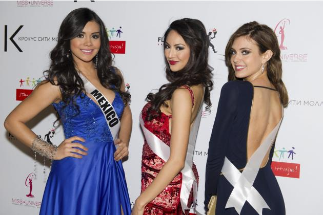 Miss Mexico 2013 Duque, Miss Canada 2013 Santos, and Miss USA 2013 Brady pose for a photo during arrivals for the National Gift Auction in Moscow