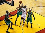 Miami Heat's Dwyane Wade (2nd R) attempt a shot during game five of their NBA Eastern Conference finals on June 5. The series winner will play the Western Conference champion, either Oklahoma City or San Antonio, in the NBA Finals