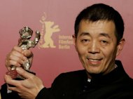 "File photo shows Chinese director Gu Changwei holding his Silver Bear at the Berlinale Film Festival in 2005. China's ""micro film"" movement has made it possible for anyone with a smartphone to become a moviemaker. ""This type of film allows almost anyone to be a director,"" Gu said"
