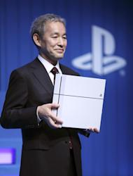 Sony Computer Entertainment Japan and Asia (SCEJA) President Atsushi Morita holds a PS4 console during SCEJA press conference in Tokyo, Monday, Sept. 1, 2014. Morita acknowledged Monday the momentum for the PlayStation 4 in Japan wasn't catching up with the West, although its cumulative global sales reached 10 million recently, the fastest pace for any game console. (AP Photo/Eugene Hoshiko)