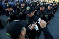 Philippine police seal the muzzles of their guns with tape in Manila on December 29, 2012 to prevent stray gunfire. Three of 13 alleged gang members killed in a shoot-out with police on Sunday were policemen, authorities said, as they began a probe into whether the violence was linked to illegal gambling