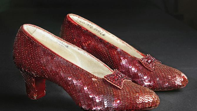 """File- This Nov. 9, 2001, file photo shows the sequin-covered ruby slippers worn by Judy Garland in """"The Wizard of Oz""""  at the offices of Profiles in History in Calabasas, Calif. Smithsonian Museum officials started a Kickstarter fundraising drive Monday, Oct. 17, 2016,  to repair the iconic slippers from 1939's """"The Wizard of Oz"""" and create a new state-of-the-art display case for them at the National Museum of American History.  (AP Photo/Reed Saxon, File)"""