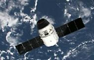This frame grab from a NASA video shows the SpaceX Dragon capsule near the ISS before linking to the station's Harmony module on May 25. The Dragon became the first privately owned spacecraft to berth with the ISS