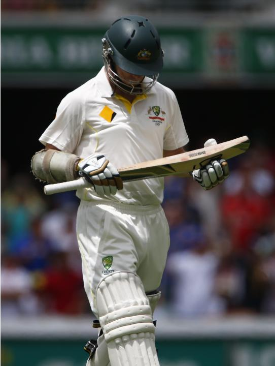Australia's Rogers walks off the field after his dismissal by England's Broad during the third day's play of the first Ashes cricket test match in Brisbane